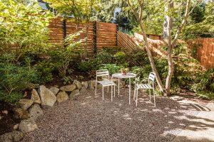 Comfortable urban backyard with white bistro set