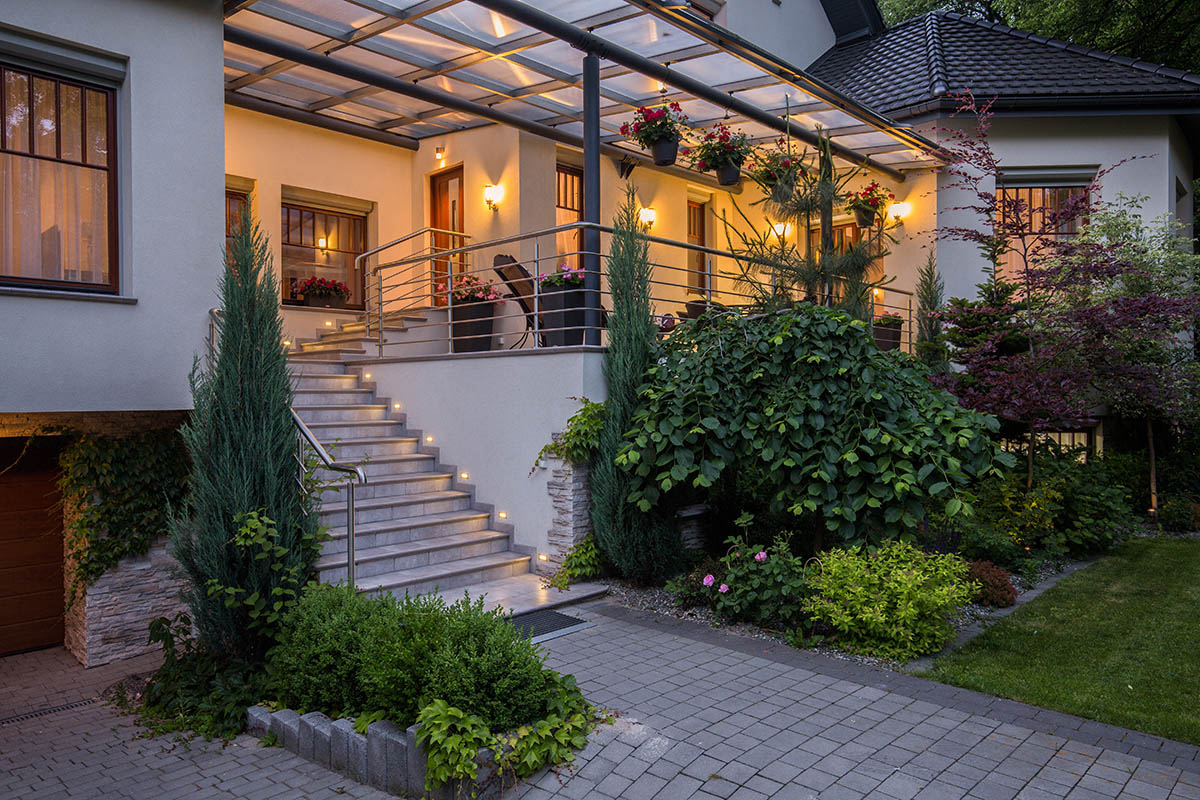 Image of main entry with stairs to luxurious house