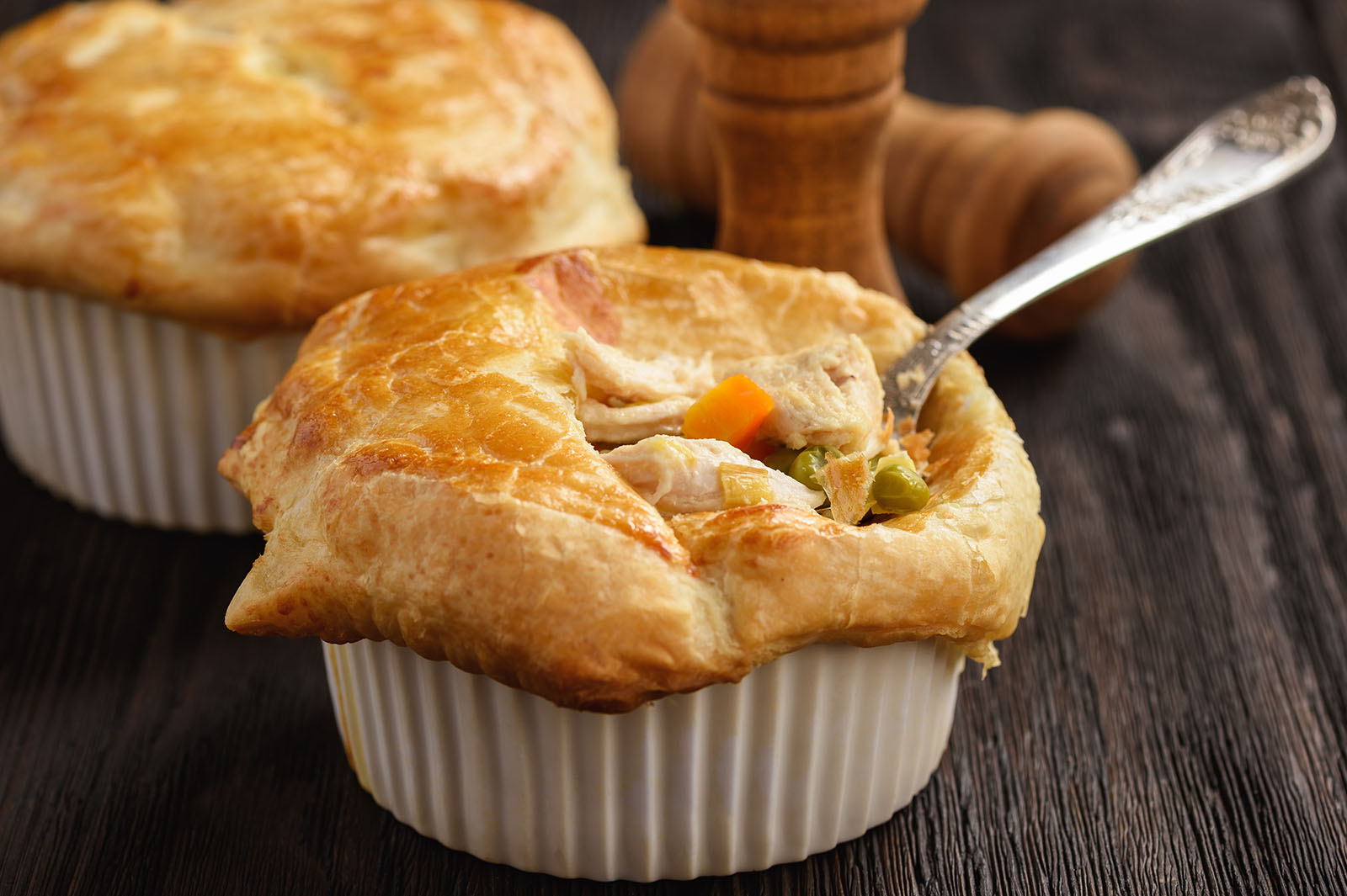 Chicken pot pie with carrot, grean peas and cheese.