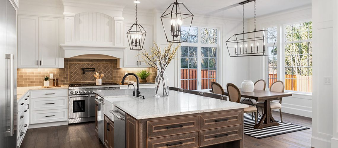 Beautiful kitchen in new traditional style luxury home, with quartz counters, hardwood floors, and stainless steel appliances