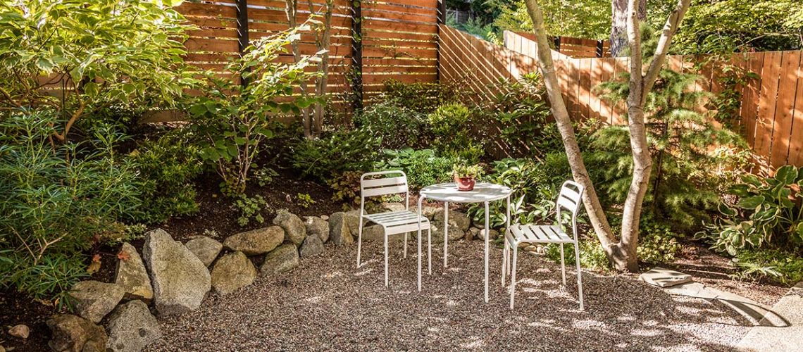 Comfortable urban backyard with white bistro set